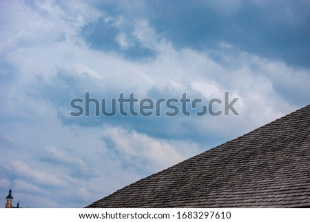 Part of the roof of an old house against the sky #1683297610