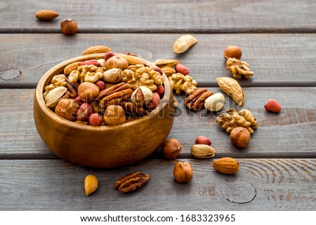 Mixed nuts in bowl - healthy snack - on wooden background #1683323965