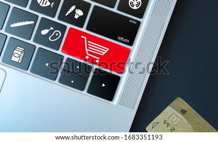 Online grocery shopping concept for fresh products when markets are closed or during confinement. Keyboard with product and cart on keypad keys. Credit card for online payment on the side #1683351193