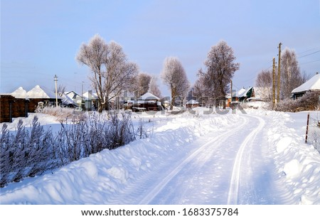 Winter snow village road view. Village road in winter snow. Winter village road. Snow winter village road scene #1683375784