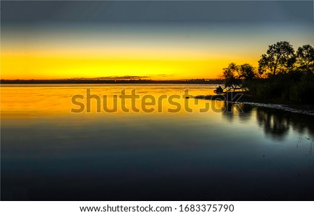 Sunset lake water horizon landscape. Sunset lake water. Sunset lake landscape. Sunset lake reflection