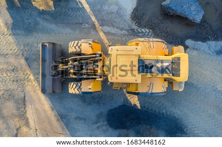 excavator on an construction site from above #1683448162