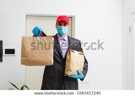 food delivery man Wearing Medical Mask. Corona Virus Concept #1683457240