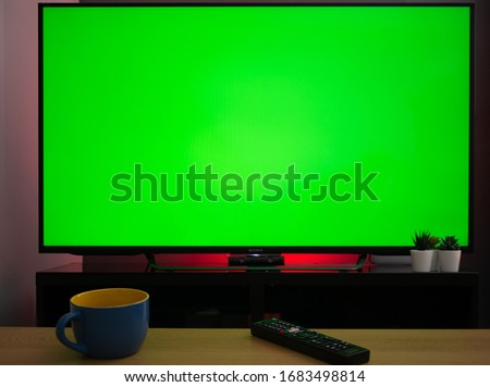 Chroma key green screen tv television screen in living room home setting