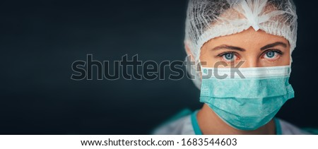 Protection against contagious disease, coronavirus. Female doctor wearing hygienic face surgical medical mask. Banner panorama medical staff preventive gear. Studio Photo, Black edit space #1683544603