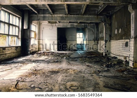 Large abandoned industrial hall. Dangerous area. Abandoned industrial interior with bright lights. Exclusion zone, radiation risk, lost city, apocalyptic building  #1683549364
