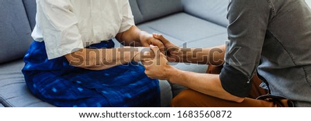 Senior woman with her home caregiver #1683560872
