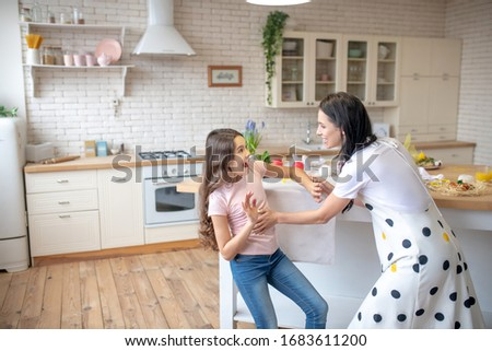 Together. Brunette woman and her cute daughter pending time together #1683611200