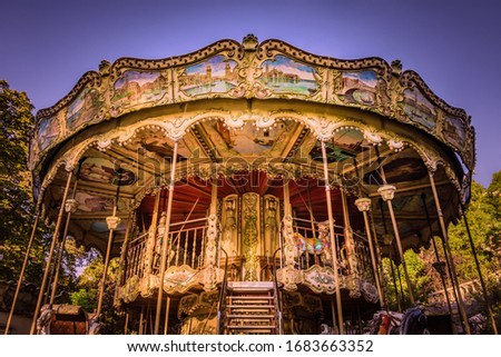 Ornate traditional carousel on a sunny morning in Montmartre, Paris, France Royalty-Free Stock Photo #1683663352