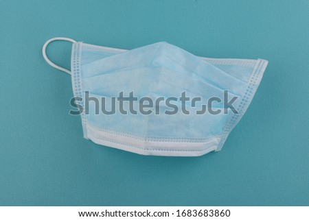 Coronavirus and Air pollution pm2.5 concept. Masks on blue background #1683683860