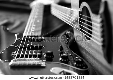 Electric guitar and acoustic guitar, black and white photo
