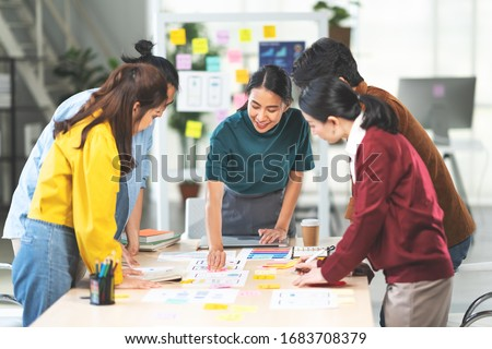 Young Asian woman leading business creative team in mobile application software design project. Brainstorm meeting, work together, internet technology, girl power, office coworker teamwork concept #1683708379