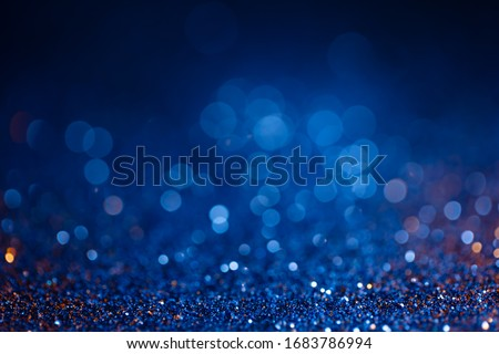 Decoration bokeh glitters background, abstract shiny backdrop with circles,modern design overlay with sparkling glimmers. Blue and golden backdrop glittering sparks with blur effect Royalty-Free Stock Photo #1683786994