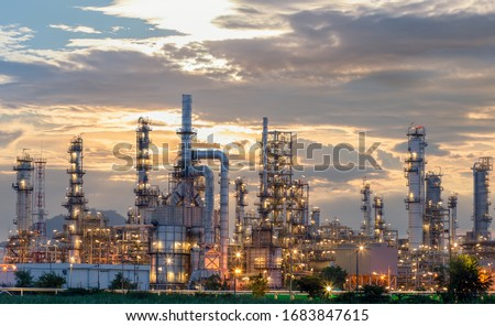 Oil refinery plant from industry zone, Aerial view oil and gas industrial, Refinery factory oil storage tank and pipeline steel at night. #1683847615