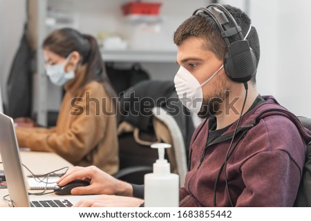 Coronavirus. Business workers working from home wearing protective mask. Small company in quarantine for coronavirus working from home with sanitizer gel. Small company concept. #1683855442