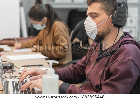 Coronavirus. Business workers working from home wearing protective mask. Small company in quarantine for coronavirus working from home with sanitizer gel. Small company concept. #1683855448