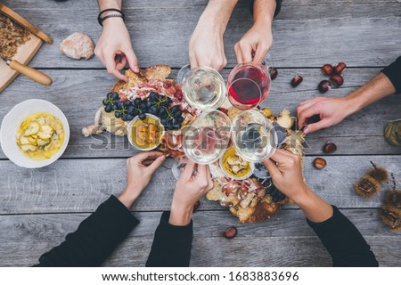 Top down of traditional rustic dinner in South Tyrol with friends #1683883696