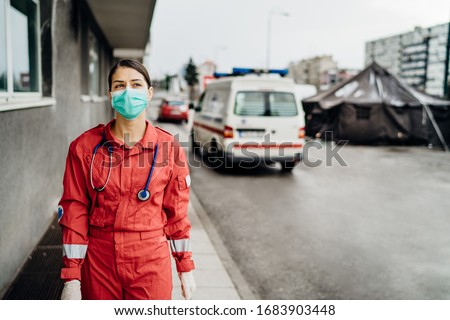 Paramedic in front of isolation hospital facility.Coronavirus Covid-19 heroes.Mental strength of medical professional.Emergency room doctor prepared for virus outbreak.Ready for hard work.Brave nurse #1683903448