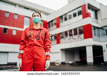 Paramedic in front of isolation hospital facility.Coronavirus Covid-19 heroes.Mental strength of medical professional.Emergency room doctor prepared for virus outbreak.Ready for hard work.Brave nurse #1683904393