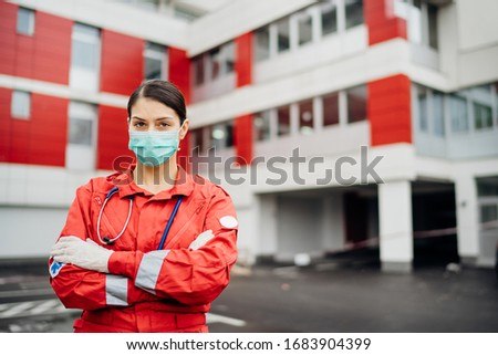 Paramedic in front of isolation hospital facility.Coronavirus Covid-19 heroes.Mental strength of medical professional.Emergency room doctor prepared for virus outbreak.Ready for hard work.Brave nurse #1683904399