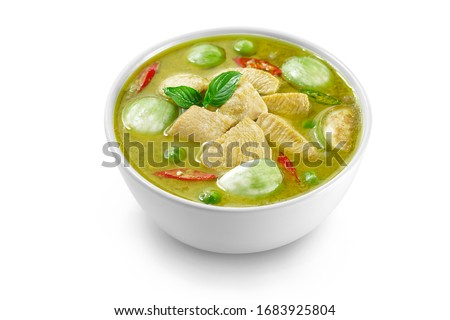 Thai food chicken green curry isolated on white background ,sliced chicken beast fillets, quartered eggplants, pea eggplant, basil leaves and pepper. #1683925804