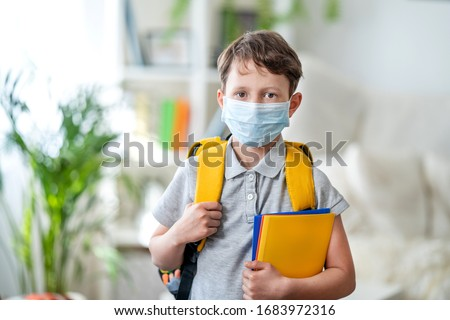 Little schoolboy wearing mask during corona virus and flu outbreak. llness protection for kids. Mask for coronavirus prevention. School kid coughing. Little boy breathes through mask, going to school. #1683972316