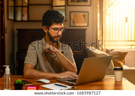 Handsome model with beard at his workplace. Home office concept. Royalty-Free Stock Photo #1683987127