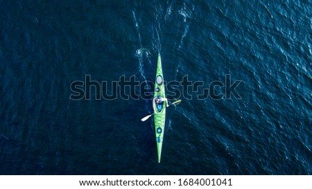 athlete kayaks on the river . Travel or kayaking concept. Drone shot, aerial view, picture with place for your text