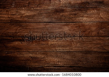 Vintage brown wood background texture with knots and nail holes. Old painted wood wall. Brown abstract background. Vintage wooden dark horizontal boards. Front view with copy space. Background for des #1684010800