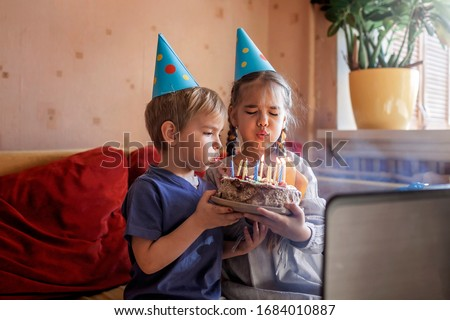 Happy family with two sibling celebrating birthday via internet in quarantine time, self-isolation and family values, online birthday party #1684010887