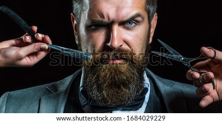 Bearded client visiting barber shop. Barber scissors and straight razor, barber shop, suit. Vintage barber shop, shaving. Portrait bearded man. Mustache men. Brutal guy, scissors, straight razor. #1684029229