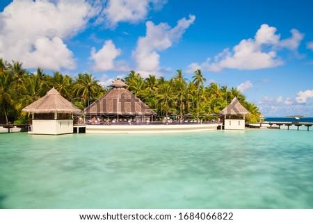 A view at the beach and waterhuts at tropical island, Maldives #1684066822