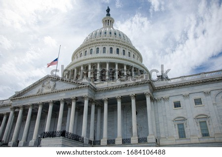 View of United States Capital through the trees Royalty-Free Stock Photo #1684106488