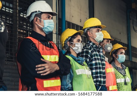 Factory workers with face mask protect from outbreak of Corona Virus Disease 2019 or COVID-19. #1684177588