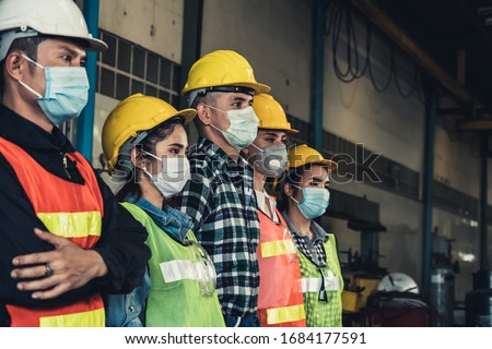 Factory workers with face mask protect from outbreak of Corona Virus Disease 2019 or COVID-19. #1684177591