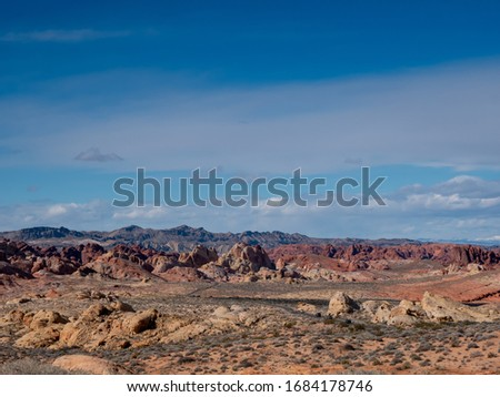 Blue sky over a road through beautiful rugged desert terrain at Valley of Fire State Park, Nevada, USA Royalty-Free Stock Photo #1684178746