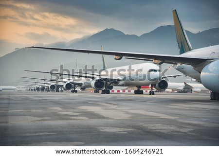 Due to  Coronavirus Covid-19 airline fleet parked at the Airport Royalty-Free Stock Photo #1684246921
