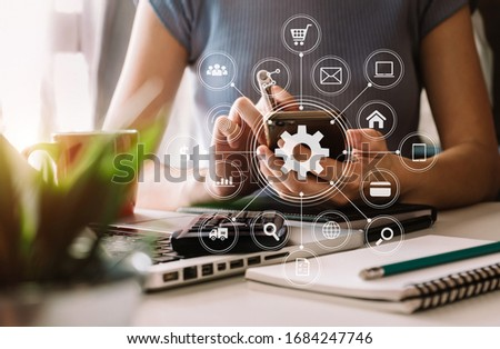 business woman hand working with laptop computer, tablet and smart phone in office with digital marketing media  in virtual icon at  office in morning light   #1684247746
