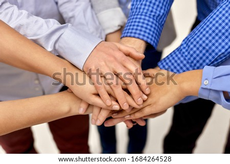 gesture, people and teamwork concept - close up of business team, friends or students stacking hands #1684264528