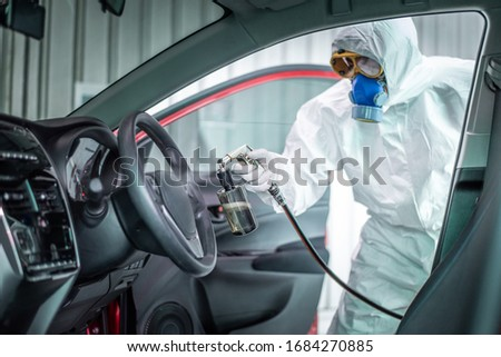Clean surfaces in car with a disinfectant spray. Help kill coronavirus in  car after going out. #1684270885