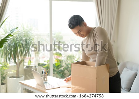 man receiving parcel at home #1684274758