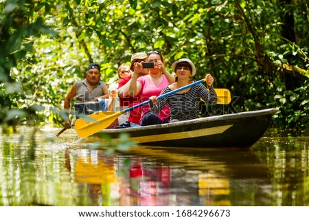 tourist boat navigating on murky amazonian water in cuyabeno wildlife reserve raft tour wildlife drive amazon tourist rafting water white team vacation nature outdoor adventure female river challenge #1684296673