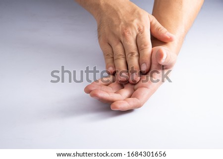 scrubbing hand by soap or cleasing oil on white acrylic sheet background #1684301656