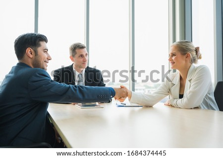 Business people shaking hands finishing up a meeting. Successful business group working at the office concept. Royalty-Free Stock Photo #1684374445