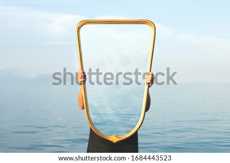 surreal image of a transparent mirror; concept of door to freedom Royalty-Free Stock Photo #1684443523