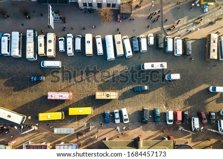 Aerial view of many cars and buses moving on a busy city street. #1684457173
