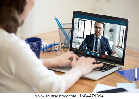 Laptop screen view confident male boss leader holding videoconference business negotiations with female partner worker employee due to coronavirus covid19 world outbreak quarantine, remote online job. #1684479364
