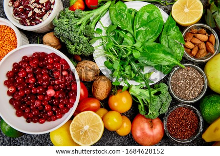 Healthy food background, trendy Virus protection food, coronavirus, immunity concept. Alkaline diet products - fruits, vegetables, cereals, nuts, oils, dark grey concrete background. Top view. #1684628152