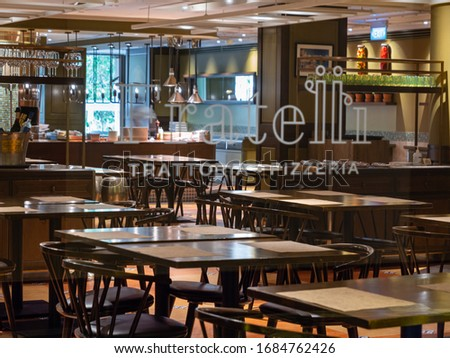 SINGAPORE – 12 MAR 2020 –  An empty closed Italian restaurant, Trattoria Pizzeria, in Resort World Sentosa. Restaurants have suffered due to covid-19 / coronavirus  #1684762426