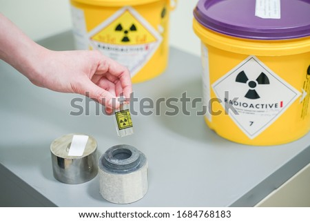 close up hand open lead box of Iodine 131(I-131)Radioactive isotopes used for hyperthyroidism treatment. #1684768183